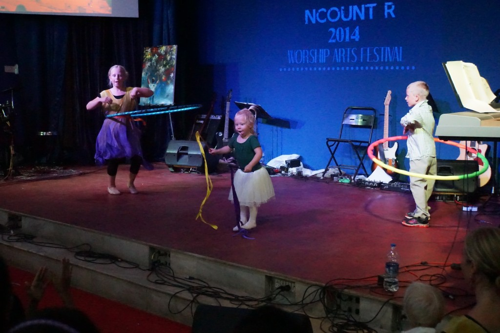 Tirzah, Judah, and Isabelle dancing and hoola hooping at the Worship Arts Festival.